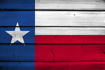 Texas State Flag on wood background