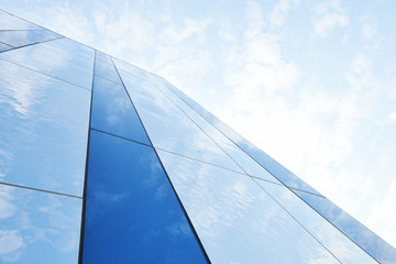Glass building against the sky