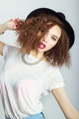 happy woman in  black hat bright makeup curly hair fashion photo