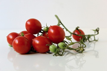 Organic red tomatoes on the stem.