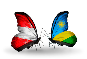 Two butterflies with flags Austria and Rwanda