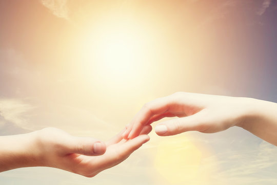 Soft, gentle touch of man and woman. Sunny sky, vintage mood
