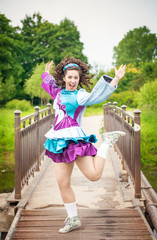 Young beautiful girl in irish dance dress having fun outdoor