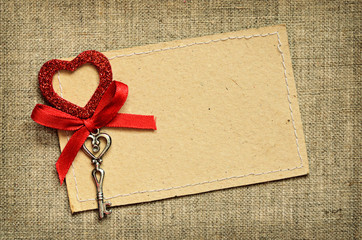 Greeting card with red ribbon and a key for Valentine's day