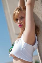 Flirtatious young woman in a cutting shirt revealing her body
