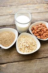 Different vegan milk in glass. Almond milk, sezame milk and oatm