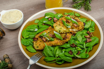 Rabbit steaks with herbs and sour cream