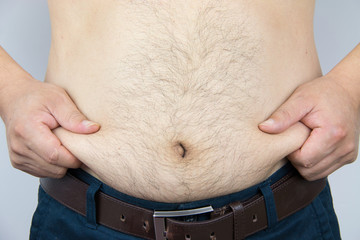Close-up man's belly