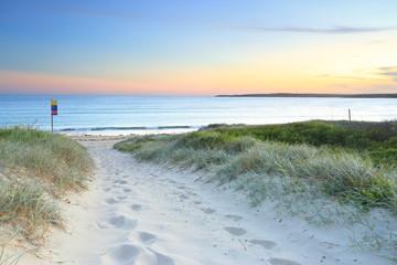 Sandy path to Greenhills Beach at dusk sundown