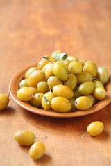 Yellow Plums on a brown plate