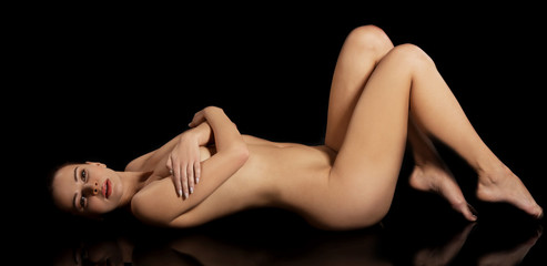Sensual nude woman in black