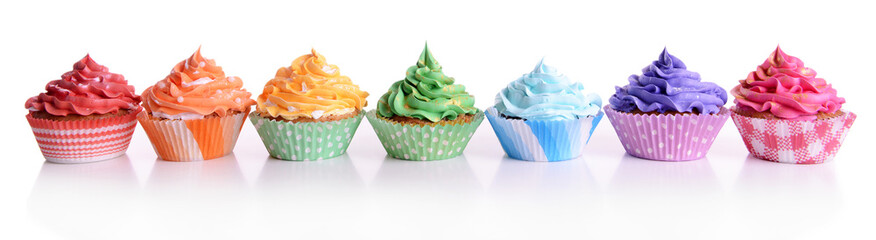 Delicious cupcakes isolated on white
