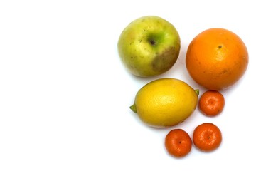 Apple, orange, lemon and tangerine. Photo.