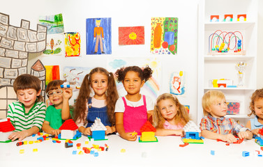 Group of little kids friends play with blocks