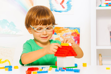 Clever little boys constructing with blocks