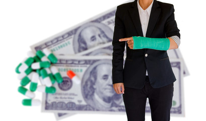 injured businesswoman with green cast on the wrist on banknote a
