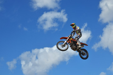 Canvas Print - MX rider on the motorbike takes off from the hill