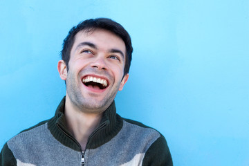 Close up face portrait of a young man laughing