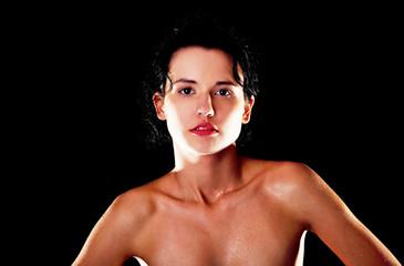 Portrait of sweaty nude woman