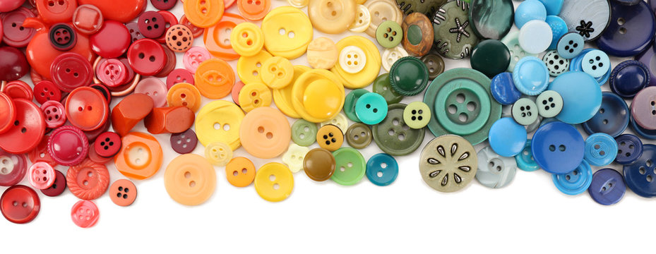 Frame of colorful sewing buttons isolated on white