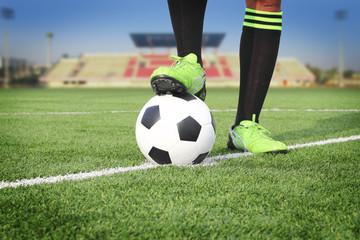 Soccer ball on field in stadium