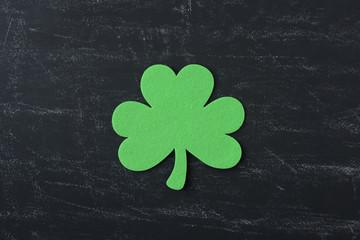 Green Clover on Chalkboard Background Background for St. Patrick