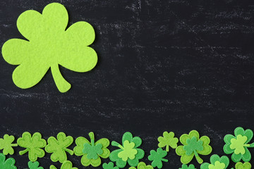 Green Clovers on Chalkboard Background Background for St. Patric