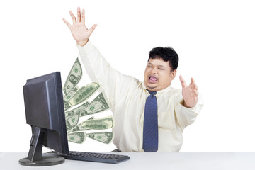 Successful businessman with money from computer