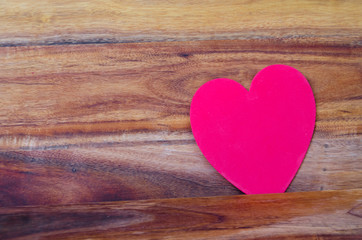 Heart on the wood background
