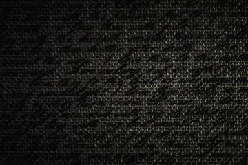 Blur text on black fabric burlap