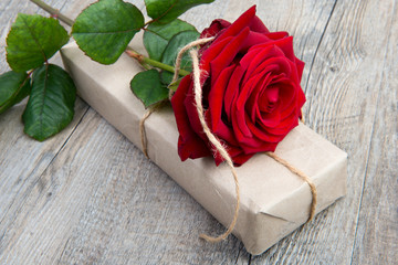 a rose and a gift for Valentine's Day
