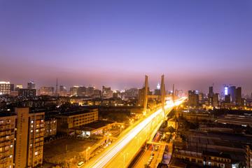 Traffic through city bridge at night in hangzhou,china