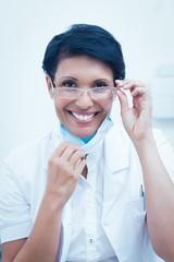 Confident female dentist smiling