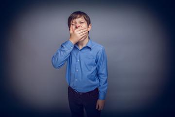 teenager boy 10 years of European appearance sleepy, yawning,