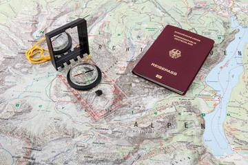 Compass and passport on a hiking map