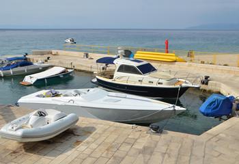 Motor yacht over harbor pier, Croatia, Europe