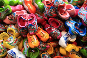 Fototapete - Dutch Souvenirs, a bunch of colored wooden shoes
