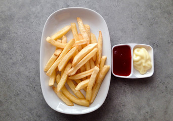 french fries with tomato sauce and mayonnaise