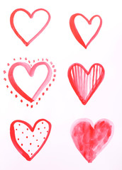 Painted hearts on sheet of paper isolated on white