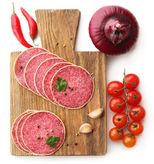 Fototapete - Slices of salami with cherry tomatoes, chili pepper, onion and