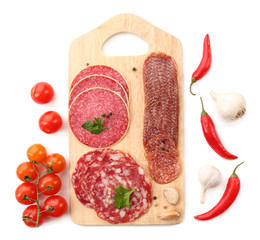 Fototapete - Various sliced salami with cherry tomatoes, chili pepper and