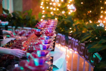 Line of different colored cocktails with smoke on a party