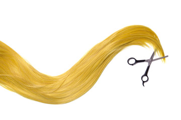 Long golden blonde hair with professional scissors