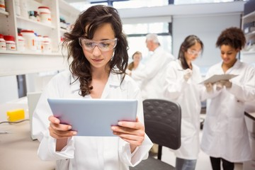 Science student looking at tablet pc