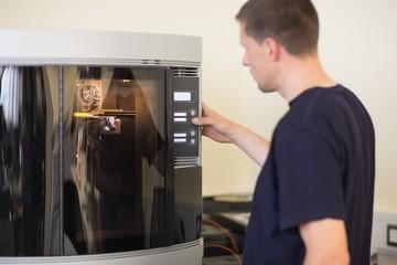 Engineering student using 3d printer