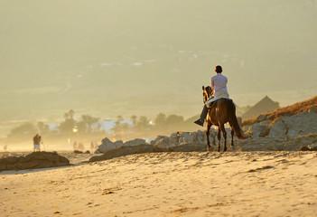 Tourist riding on the beach of Bolonia, Tarifa, Spain
