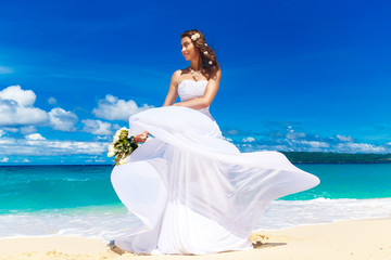 beautiful brunette bride in white wedding dress with big long wh