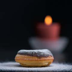 Romantic decoration with donut and candle