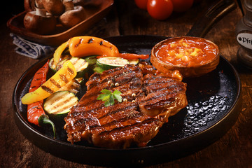 Grilled Steak with Vegetables on Cast Iron Pan