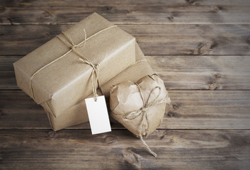 Heart and box wrapped in brown kraft paper with a price tag,  on